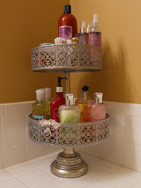 Use a cake stand as a bathroom caddy