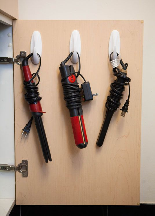 Use Command Hooks Inside Bathroom Cabinet For Storing Hair Tools