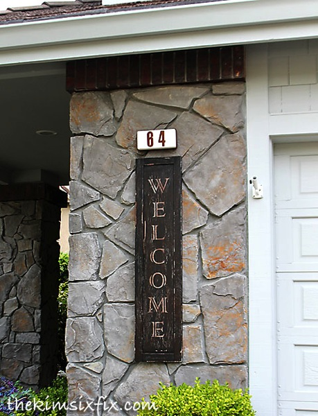 Vintage Welcome Sign from an Old Cabinet Door
